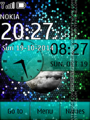Stars with Analog Clock es el tema de pantalla